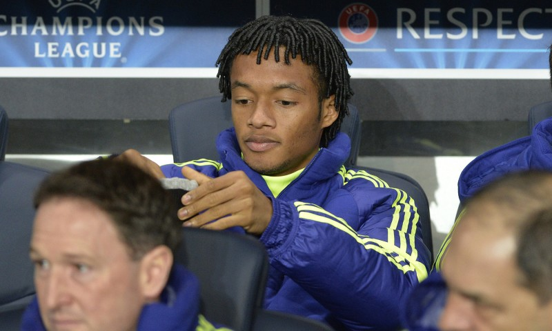 Chelsea's new Colombian midfielder Juan Cuadrado sits on the bench ahead of the UEFA Champions League round of 16 football match between Paris Saint-Germain (PSG) and Chelsea at the Parc des Princes stadium in Paris on February 17, 2015.  AFP PHOTO / MIGUEL MEDINA        (Photo credit should read MIGUEL MEDINA/AFP/Getty Images)