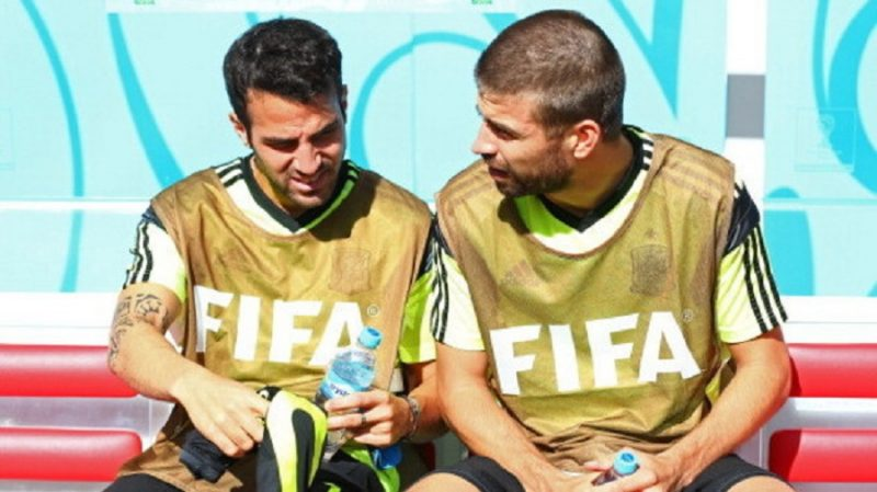 451097322-cesc-fabregas-and-gerard-pique-of-spain-look-on-from