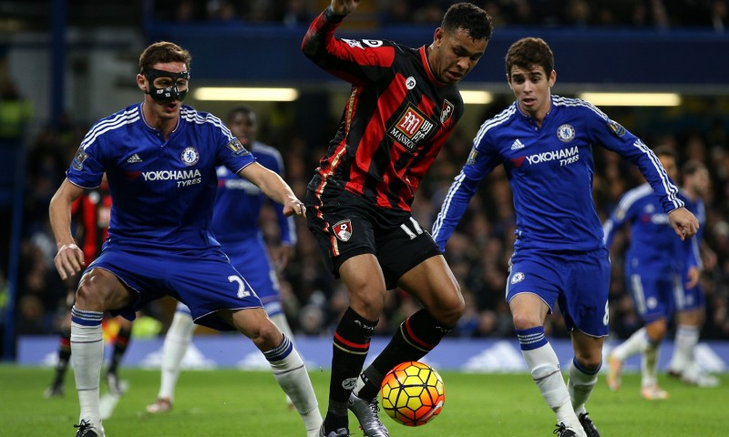 LONDON, ENGLAND - DECEMBER 05: Joshua King (C) of Bournemouth controls the ball under pressure of Nemanja Matic (L) and Oscar (R) of Chelsea during the Barclays Premier League match between Chelsea and A.F.C. Bournemouth at Stamford Bridge on December 5, 2015 in London, England.  (Photo by Ian Walton/Getty Images)
