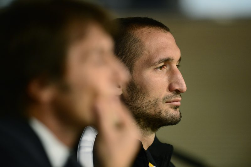 Juventus coach Antonio Conte (L) and defender Giorgio Chiellini sit during a press conference on the eve of the UEFA Champions League football match Real Madrid vs Juventus on October 22, 2013 at the Santiago Bernabeu stadium in Madrid.    AFP PHOTO / JAVIER SORIANO        (Photo credit should read JAVIER SORIANO/AFP/Getty Images)