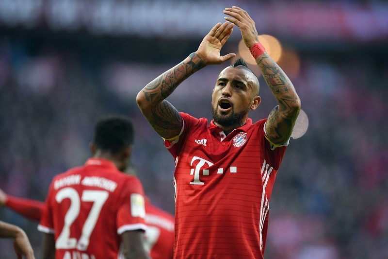 MUNICH, GERMANY - DECEMBER 10: Arturo Vidal of Muenchen celebrates after Robert Lewandowski of Muenchen scores his team's second goal during the Bundesliga match between Bayern Muenchen and VfL Wolfsburg at Allianz Arena on December 10, 2016 in Munich, Germany.  (Photo by Matthias Hangst/Bongarts/Getty Images)