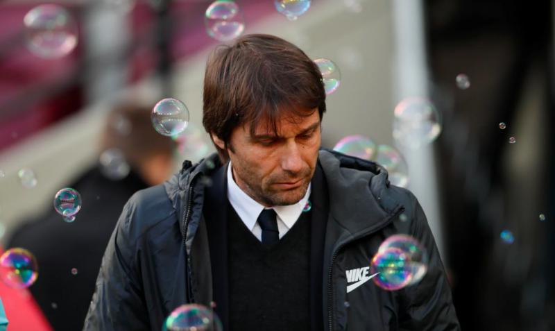 Antonio Conte makes his way through the bubbles against West Ham.
