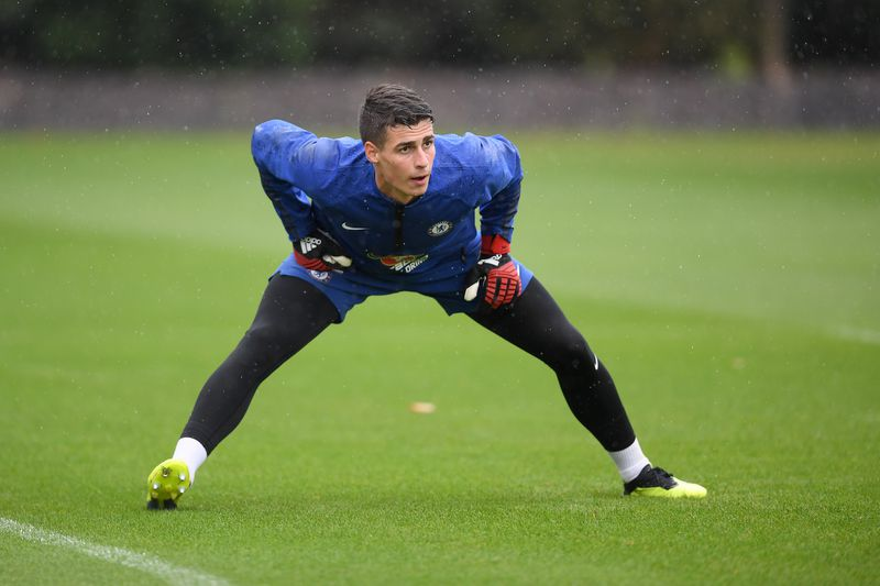Kepa Arrizabalaga does physical stretches in first Chelsea training